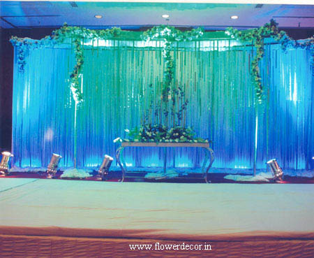 Torquise Blue backdrop for ring ceramony